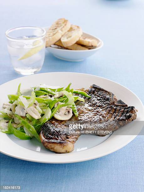 Plate of grilled meat with salad