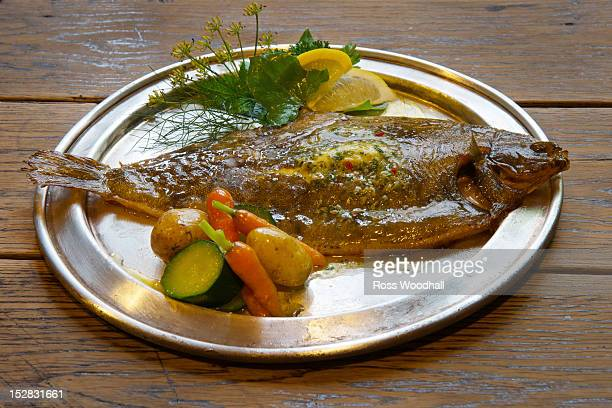 Plate of grilled plaice and vegetables