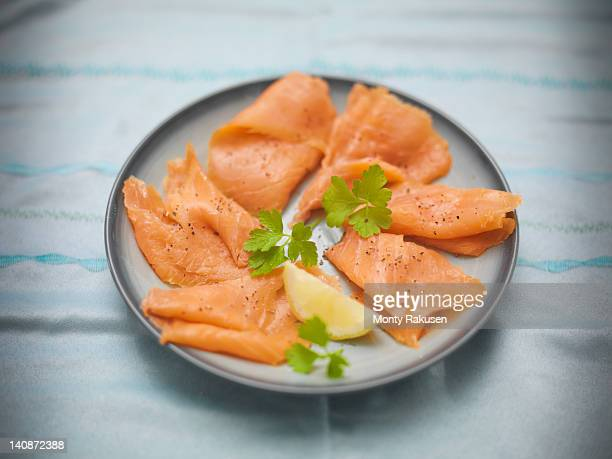 plate of hand reared scottish smoked salmon - salmone affumicato foto e immagini stock