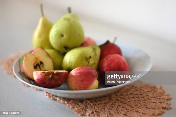A plate of homegrown apples and pears