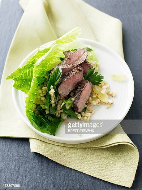 Plate of lamb and grape salad