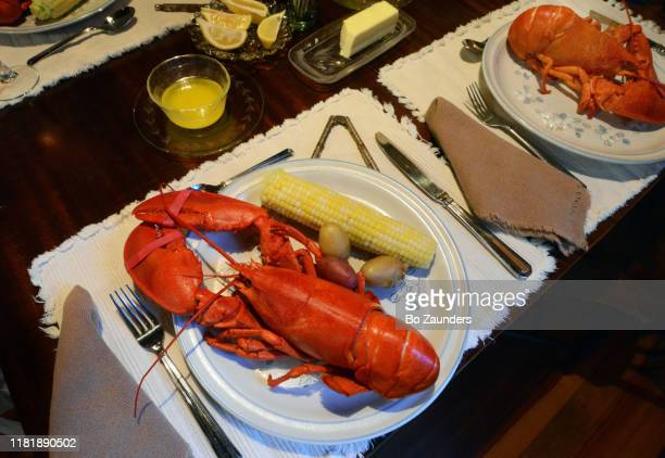 plate of lobster and corn on the cob - bo zaunders stock pictures, royalty-free photos & images