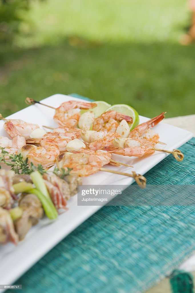 Plate of mixed grilled skewers : Stock Photo