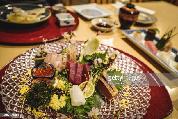 plate of mixed sashimi as one course of japanese kaiseki cuisine, a traditional multi-course japanese dinner - コース料理 ストックフォトと画像
