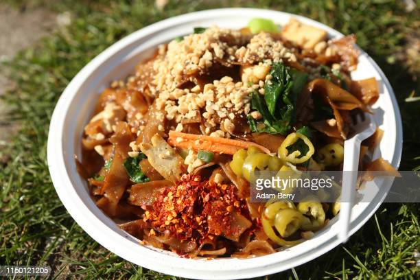A plate of pad see ew noodles is seen at the 'Thai Park' on May 18 2019 in Berlin Germany Preussenpark in the Wilmersdorf district of Berlin is known...