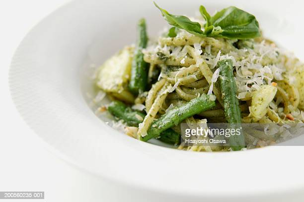 Plate of pasta with genobese pesto, close-up