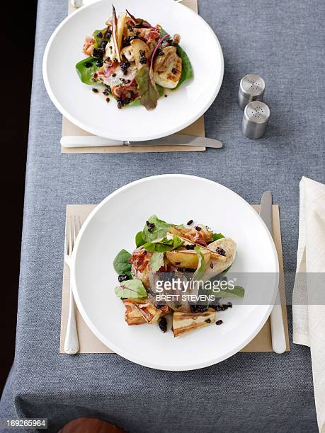Plate of pheasant with parsnip salad