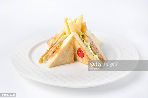 Plate of pork chop sandwiches with Potato Chips