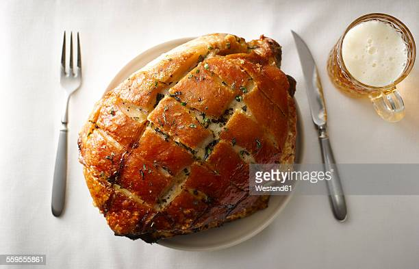 Plate of pork roast with crackling on laid table