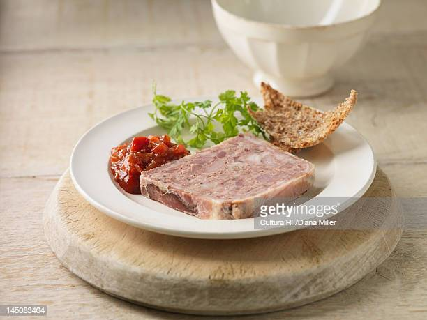 plate of pork terrine with chutney - pate stock photos and pictures
