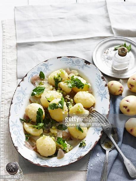 Plate of potato salad with basil