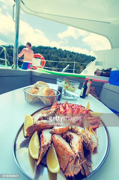 Plate of prawns and seafood being served on a boat.