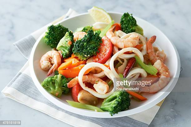Plate of prawns, squid and vegetables