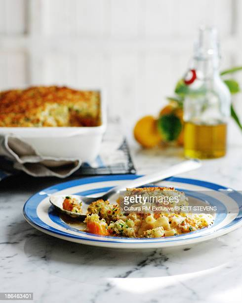 Plate of pumpkin pasta bake with breadcrumbs