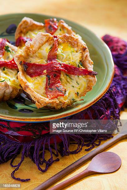 Plate of quiches on placemat