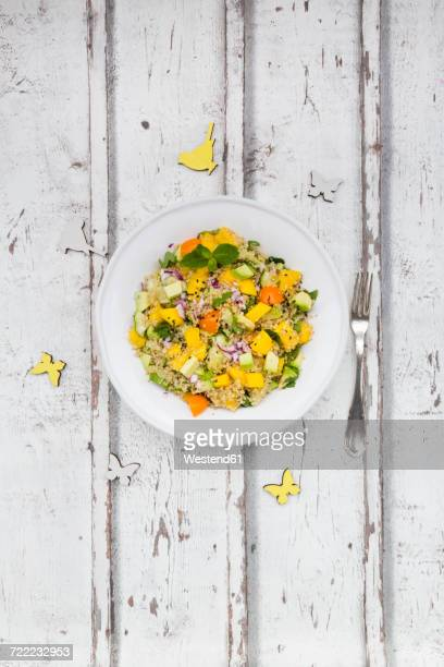 plate of quinoa salad with mango, avocado, tomatoes, cucumber, herbs and black sesame - flat leaf parsley stock pictures, royalty-free photos & images