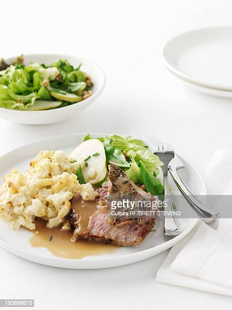 Plate of roast lamb with potatoes