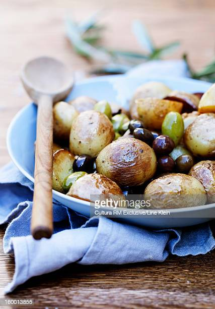 Plate of roasted potatoes and olives