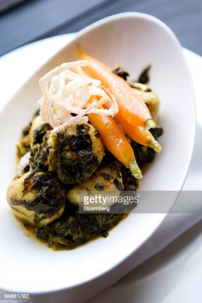 A plate of saag paneer gnudi is arranged for a photo at Elettaria a restaurant in New York US on Sunday March 9 2008 Elettaria is located in New...