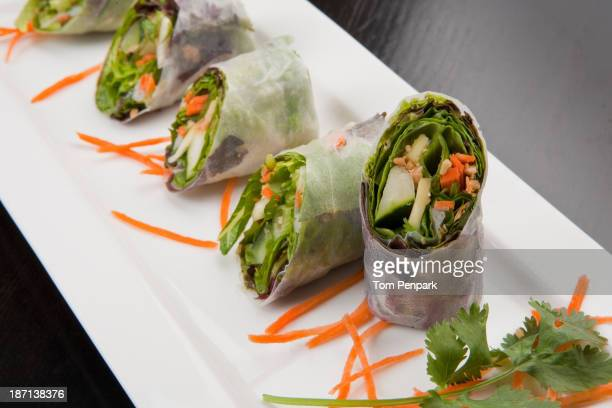 Plate of salad rolls with carrots