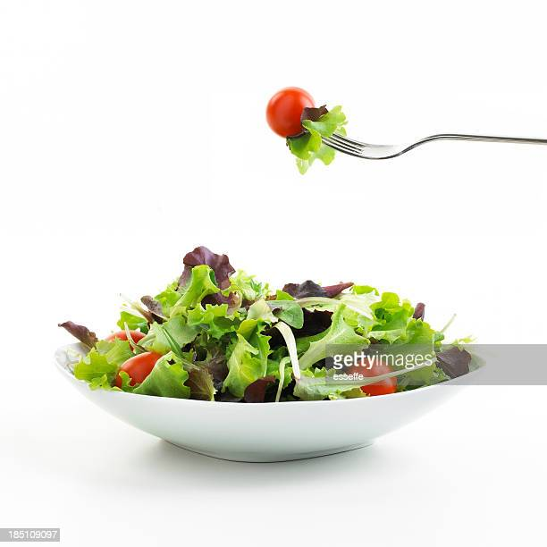 plate of salad with fork - salad stock pictures, royalty-free photos & images