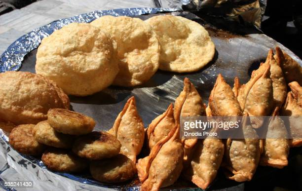 Plate of samosa, pattice and bhature in Manali, Himachal Pradesh, India.