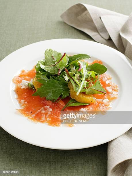 Plate of smoked salmon with salad