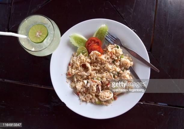 a plate of squid fried rice, typical thai seafood - argenberg stock pictures, royalty-free photos & images