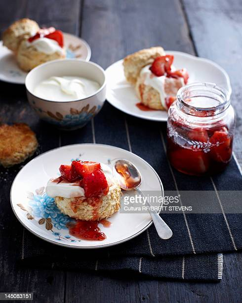 Plate of strawberry shortcake with cream