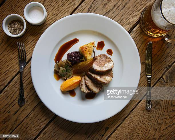 plate of stuffed pork with pear - gourmet stock pictures, royalty-free photos & images