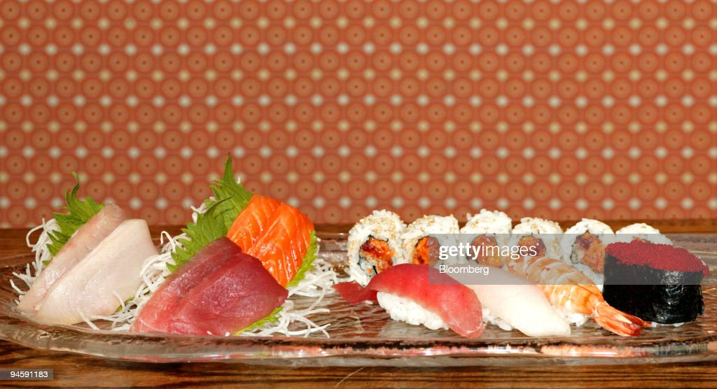 A plate of sushi, sashimi and Tobiko, flying fish eggs, is