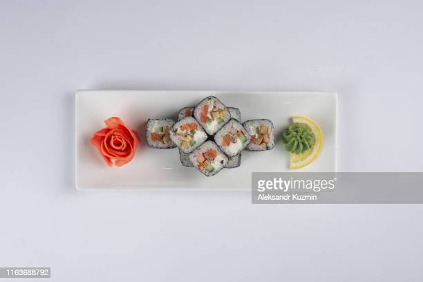 plate of sushi with pickled ginger and wasabi - wasabi stock pictures, royalty-free photos & images