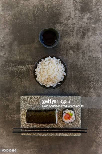 Plate of sushi with rice and chopsticks