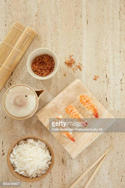 plate of sushi with rice and ginger - nigiri stock pictures, royalty-free photos & images