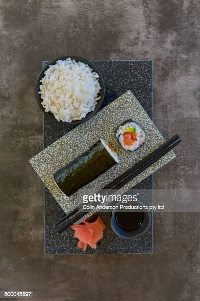 Plate of sushi with rice and pickled ginger