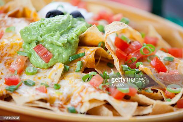 plate of tasty nachos - nachos stock pictures, royalty-free photos & images
