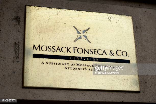 A plate of the Geneva office of the law firm Mossack Fonseca is seen on June 16 2016 in Geneva An information technology worker at the Geneva office...