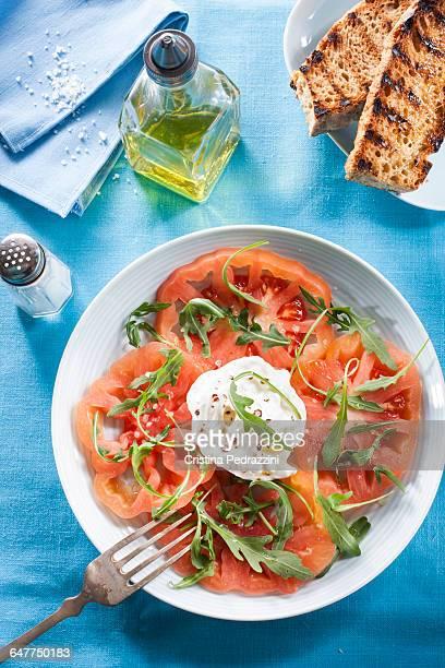 A plate of tomato and Mozzarella Caprese Salad