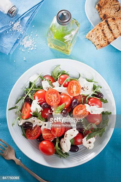 A plate of tomato, Mozzarella and Rocket Salad.