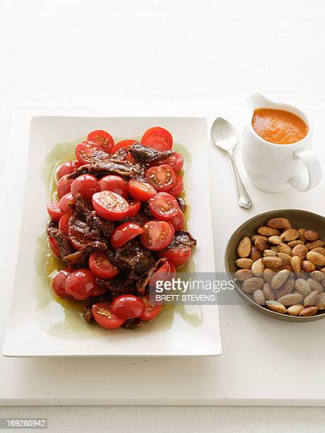 Plate of tomato salad with almonds