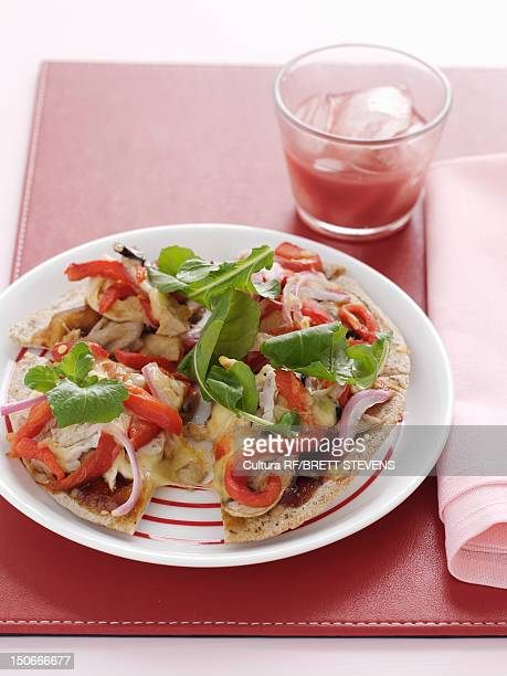 plate of vegetable pizza - arugula stock pictures, royalty-free photos & images