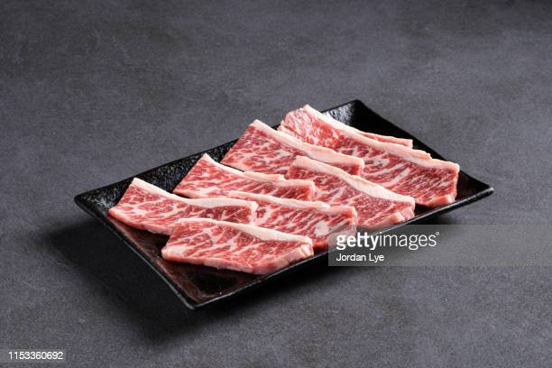 plate of wagyu kobe beef - beef stock pictures, royalty-free photos & images