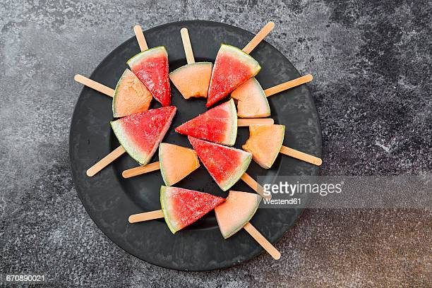Plate of watermelon and rockmelon popsicles