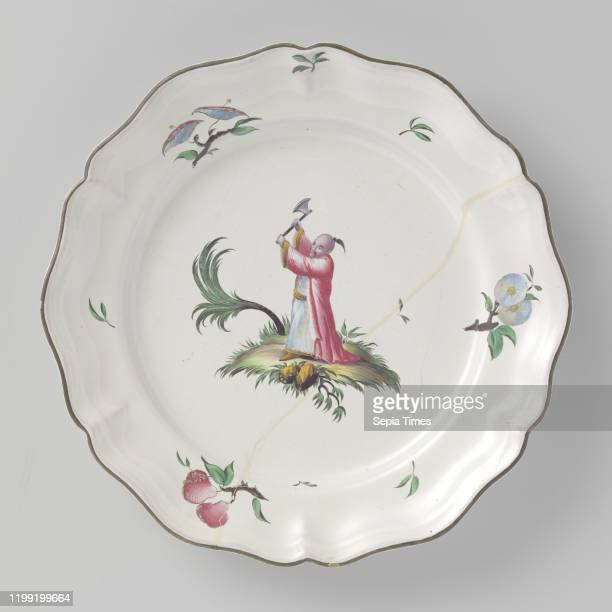 Plate, painted with chinoiserie, Round plate of multicolored painted faience, with a scalloped edge. A Chinese is painted on the shelf, lifting an ax...
