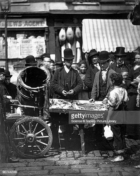 Plate produced using the Woodburytype process of a fish seller taken from 'Street Life in London' written by Adolphe Smith with photography by...