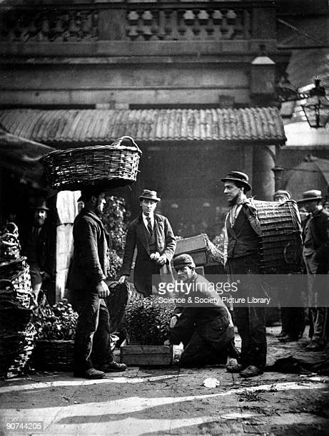 Plate produced using the Woodburytype process showing market stall labourers at work taken from 'Street Life in London' written by Adolphe Smith with...
