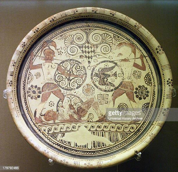 Plate showing Menelaus and Hector fighting over the body of EuphorbosMade on Rhodes about 600 BC From Kamiros Rhodes