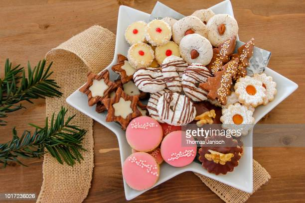 plate with a big selection of christmas cookies - christmas cookies stock pictures, royalty-free photos & images