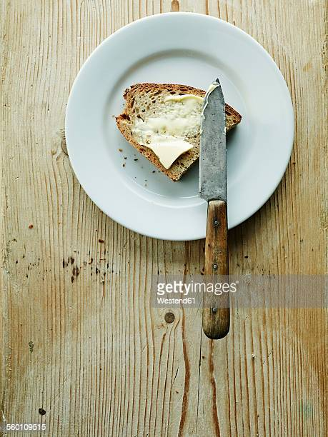 plate with bread and butter - spreading stock pictures, royalty-free photos & images