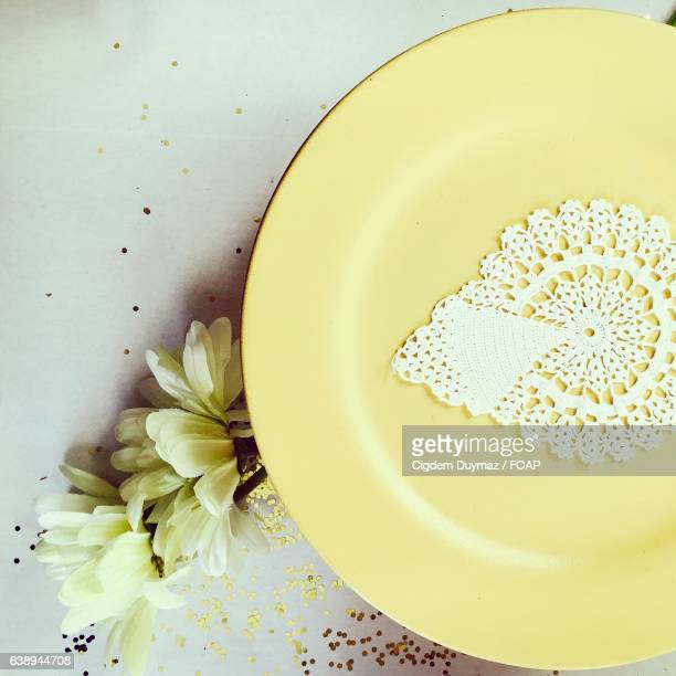 plate with doily and fresh flower on table - doily stock photos and pictures